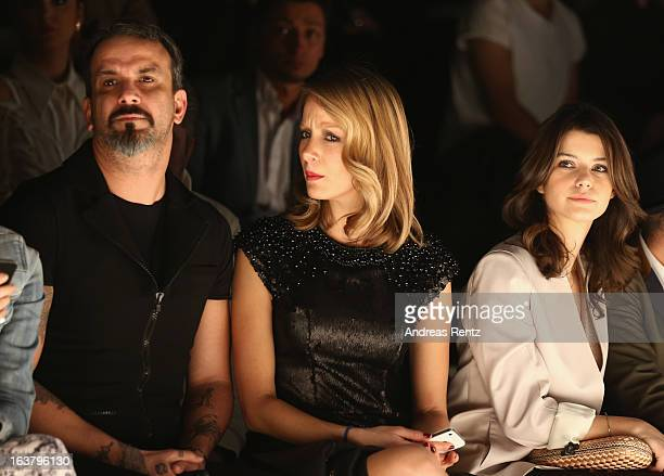 Ferhat Kazanci Bade Iscil and Beren Saat attend the Soul By Ozgur Masur show during Mercedes Benz Fashion Week Istanbul Fall/Winter 2013/14 at...