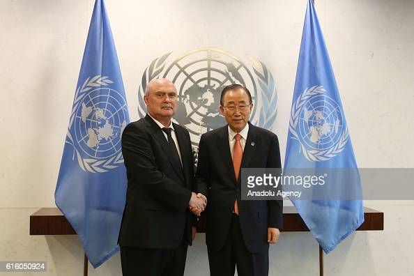 Feridun Sinirlioglu Turkey's permanent representative to the United Nations in New York shakes hands with UN SecretaryGeneral Ban Kimoon in New York...