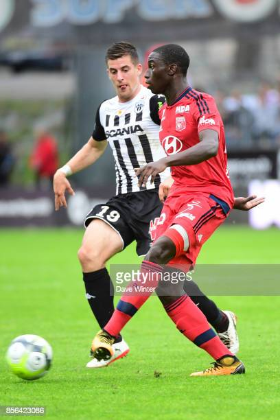 Ferland Mendy of Lyonand Baptiste Santamaria of Angers during the Ligue 1 match between Angers SCO and Olympique Lyonnais at Stade Raymond Kopa on...