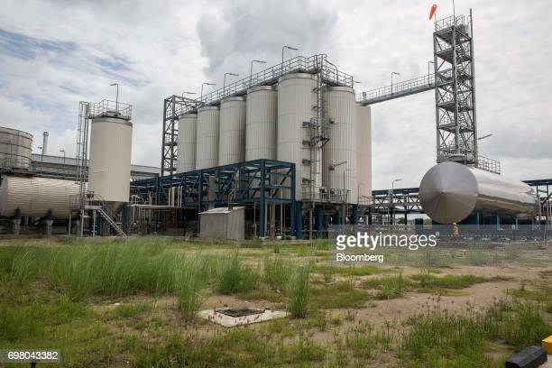 Fermentation tanks stand at the Heineken NV brewery in Yangon Myanmar on June 15 2017 Heineken is seeking to exploit the potential of the southeast...