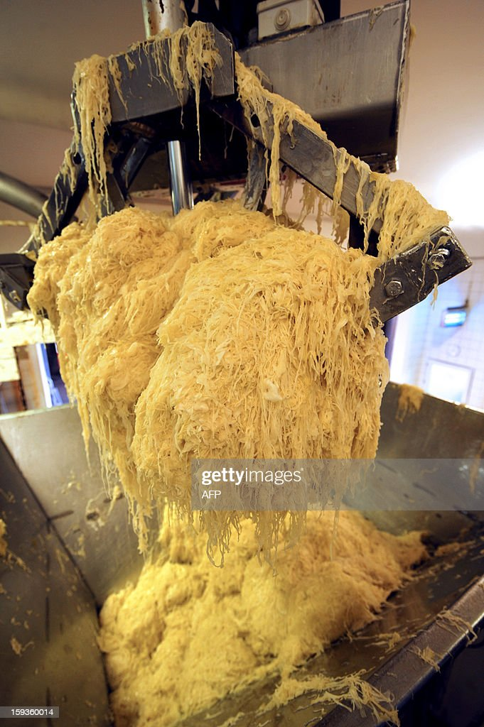 Fermented cabbage is put in a tank of the processing line of a sauerkraut unit of Charles Christ, a French firm specialized in canned cooked dishes and condiments, on January 11, 2013 at Connerre, western France.
