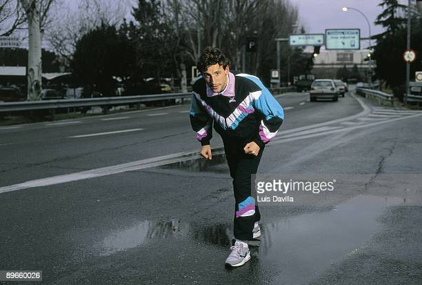 Fermin Cacho athlete Simulating the exit of a race in a wet freeway