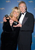 Fern Britton and Paul O'Grady during 2004 National Television Awards Pressroom at Royal Albert Hall in London Great Britain