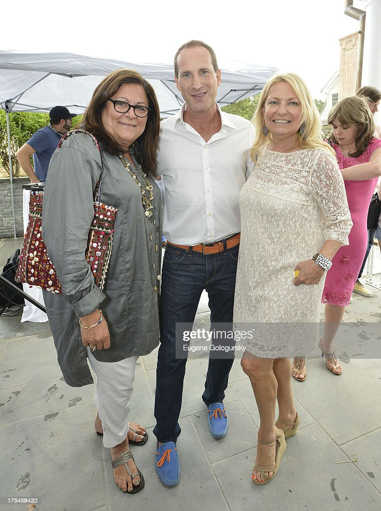 <a gi-track='captionPersonalityLinkClicked' href=/galleries/search?phrase=Fern+Mallis&family=editorial&specificpeople=201774 ng-click='$event.stopPropagation()'>Fern Mallis</a>, Josh Guberman and <a gi-track='captionPersonalityLinkClicked' href=/galleries/search?phrase=Debra+Halpert&family=editorial&specificpeople=691655 ng-click='$event.stopPropagation()'>Debra Halpert</a> attend the Hamptons Magazine Celebrates With Cover Stars, Jonathan Adler And Simon Doonan at Day Lily Estate on August 3, 2013 in Bridgehampton, New York.