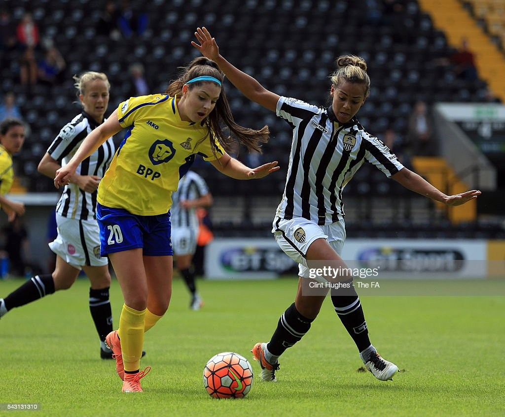 Fern Whelan (R) of Notts County Ladies FC and Carla Humphrey of Doncaster Rovers Belles battle for the ball during the FA WSL 1 match between Notts County Ladies FC and Doncaster Rovers Belles at the Meadow Lane Stadium on June 26, 2016 in Nottingham, England