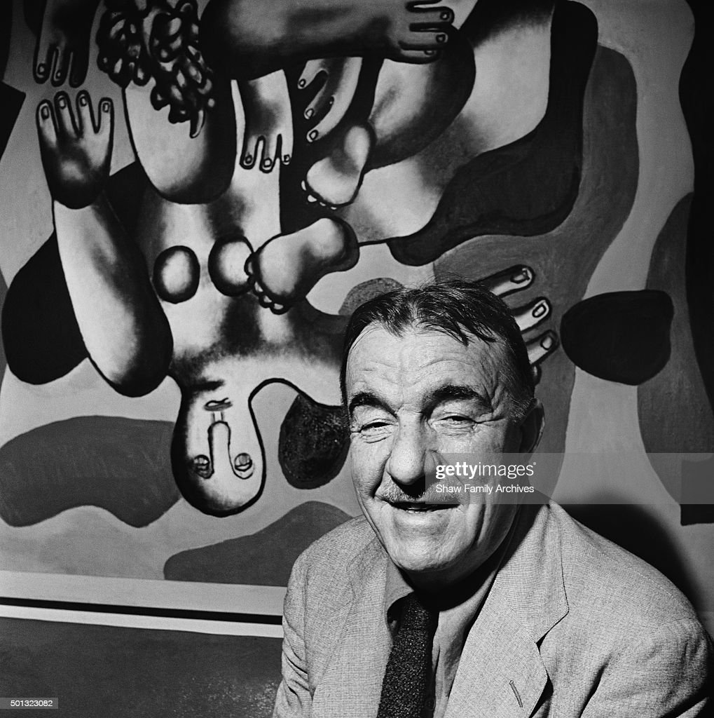 <a gi-track='captionPersonalityLinkClicked' href=/galleries/search?phrase=Fernand+Leger&family=editorial&specificpeople=954169 ng-click='$event.stopPropagation()'>Fernand Leger</a> in front of his painting 'Plongeur Sur Fond Jaune' at the Museum of Modern Art in 1944 in New York, New York.