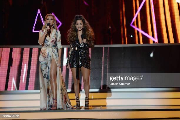 Fernanda Castillo and Carmen Villalobos on stage at Telemundo's 2017 'Premios Tu Mundo' at American Airlines Arena on August 24 2017 in Miami Florida