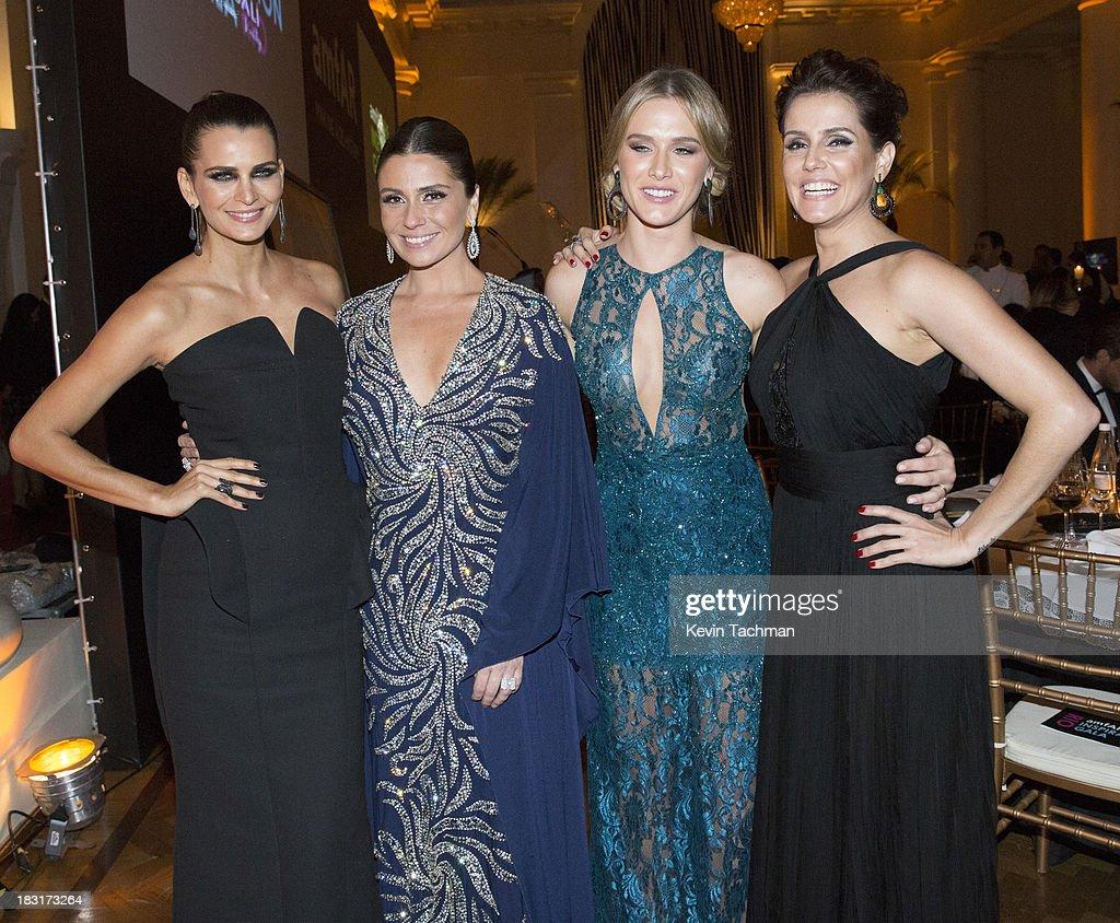 Fernanda Mota, Giovanna Antonelli, Fiorella Mattheis and Deborah Secco attend the amfAR Inspiration Gala Rio on October 4, 2013 in Rio de Janeiro, Brazil.