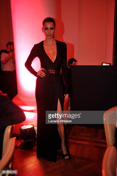 Fernanda Motta poses for a photo during the opening dinner and charity auction of the Oi Fashion Rocks at Copacabana Palace on October 23 2009 in Rio...