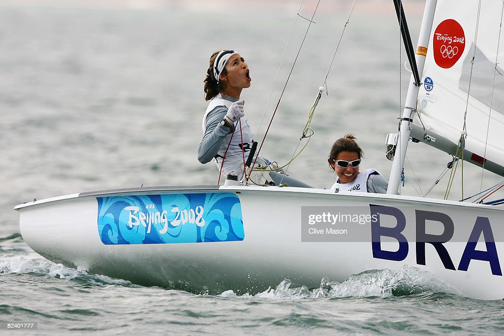 Fernanda Oliveira and Isabel Swan of Brazil celebrate after finishing third in the Women's 470 class event held at the Qingdao Olympic Sailing Center...