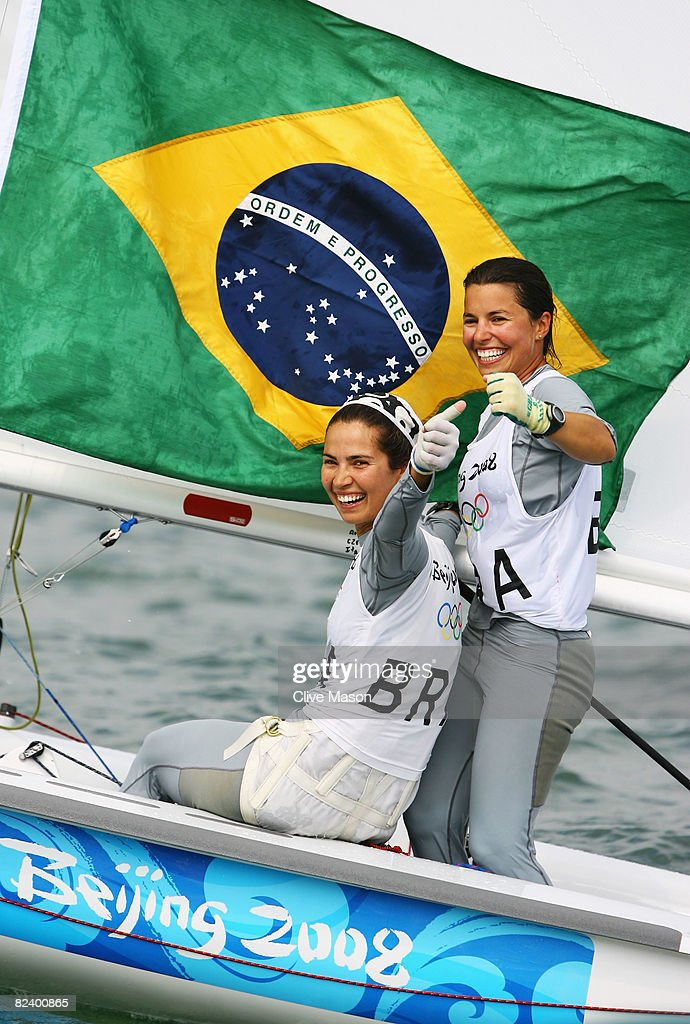 Fernanda Oliveira and Isabel Swan of Brazil celebrate after they finished third overall in the Women's 470 class event held at the Qingdao Olympic...