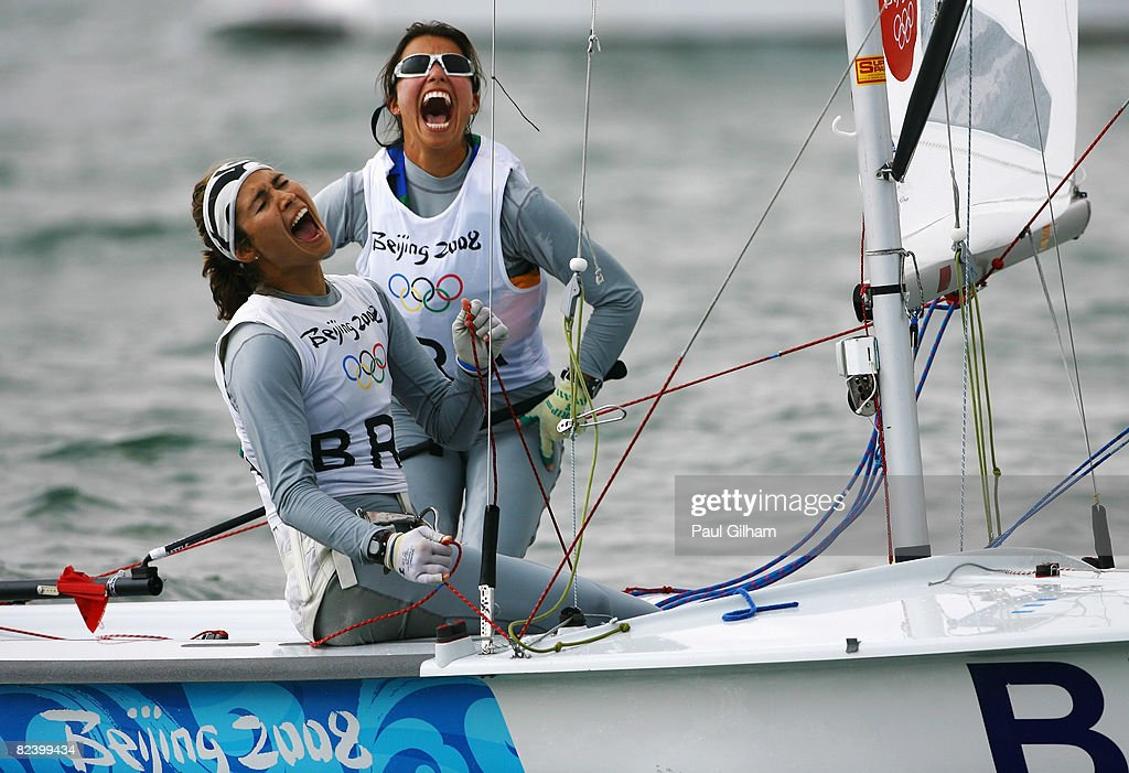 Fernanda Oliveira and Isabel Swan of Brazil celebrate finishing third overall following the Women's 470 class medal race held at the Qingdao Olympic...