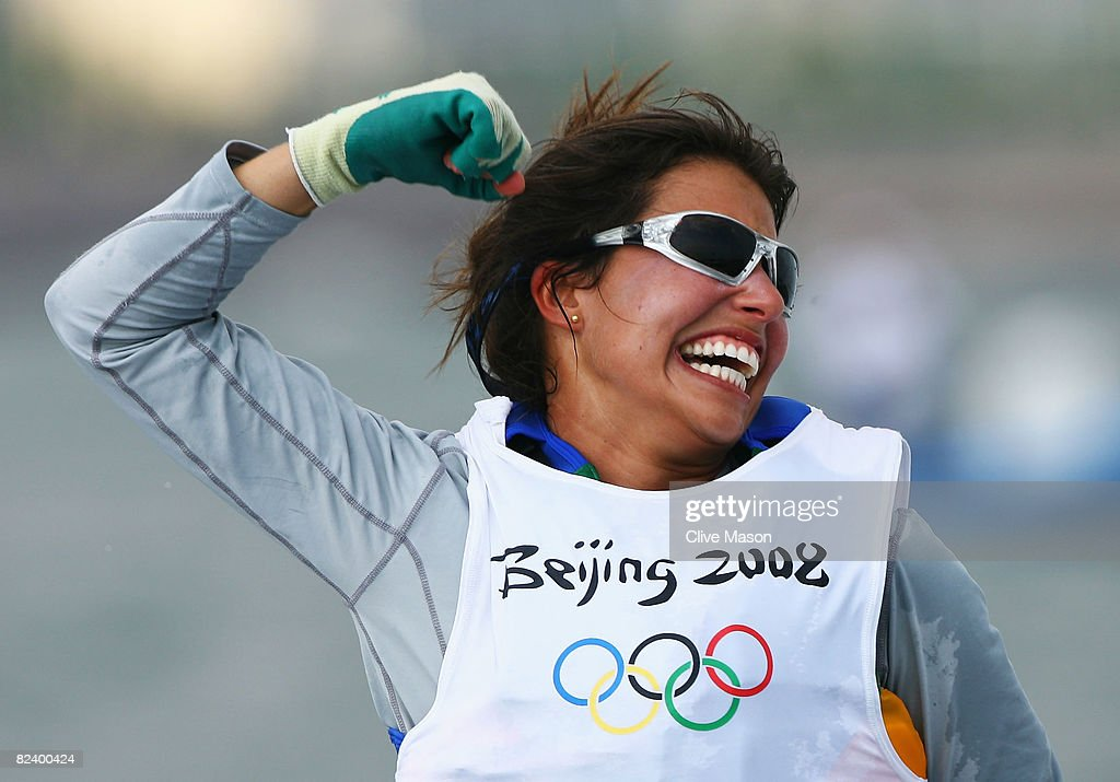 Fernanda Oliveira of Brazil celebrates after finishing third overall with team mate Isabel Swan in the Women's 470 class event held at the Qingdao...
