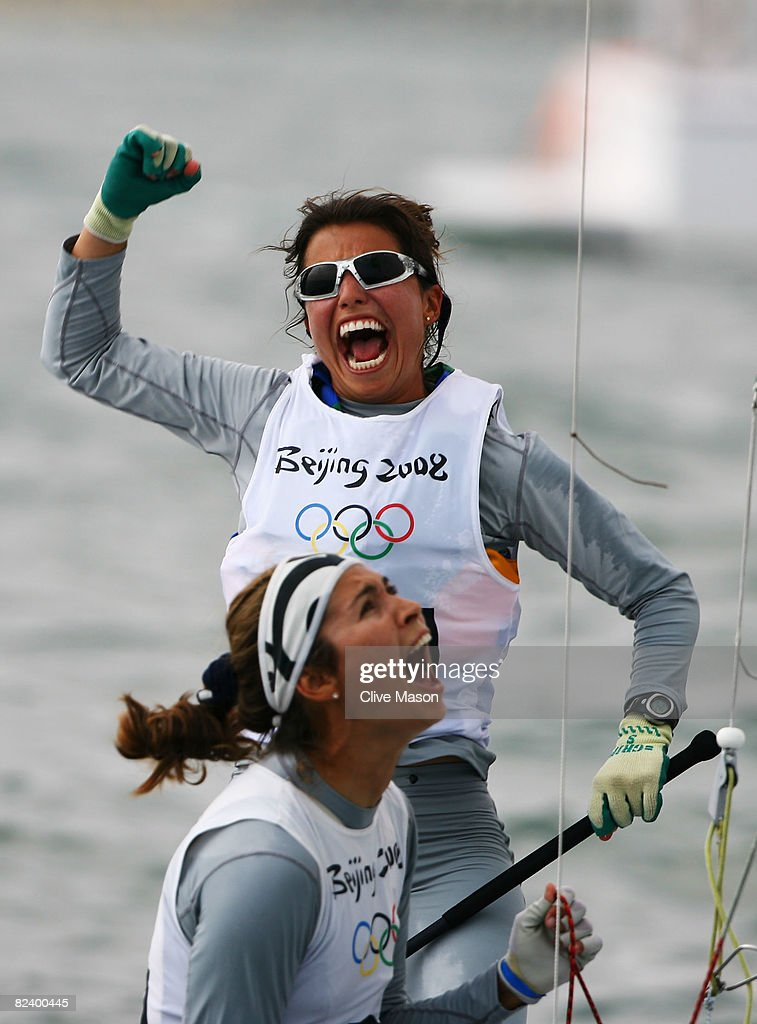 Fernanda Oliveira of Brazil celebrates with team mate Isabel Swan after they finished third overall in the Women's 470 class event held at the...