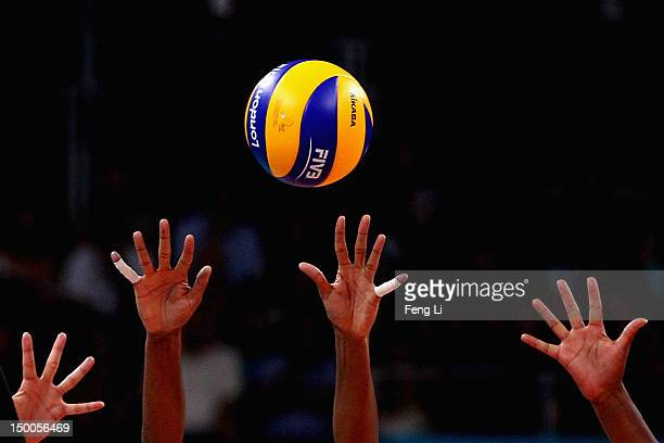 Fernanda Rodrigues and Thaisa Menezes of Brazil defend the ball from Saori Kimura of Japan during the Women's Volleyball semifinal match on Day 13 of...