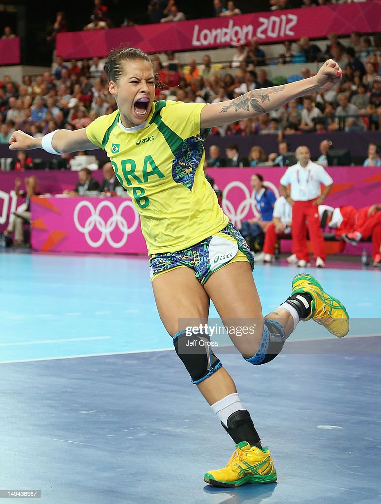 Fernanda Silva Rocha of Brazil celebrates scoring a goal in the Women's Handball preliminaries Group A - Match 3 between Croatia and Brazil on Day 1 of the London 2012 Olympic Games at the Copper Box on July 28, 2012 in London, England.