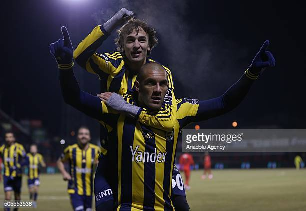 Fernandao of Fenerbahce celebrates with his teammate after scoring a goal during the Turkish Spor Toto Super Lig football match between Eskisehirspor...