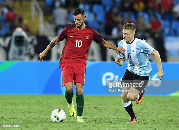 Fernandes Bruno of Portugal and Santiago Ascacibar of Argentina compete for the ball during the Men's Group D first round match between Portugal and...