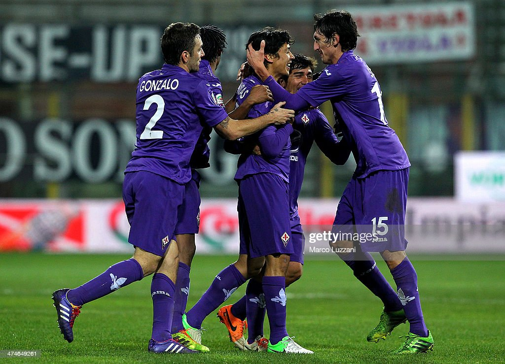 Fernandez Ariel Matias (C) of ACF Fiorentina celebrates his goal with his team-mates <a gi-track='captionPersonalityLinkClicked' href=/galleries/search?phrase=Stefan+Savic&family=editorial&specificpeople=6135329 ng-click='$event.stopPropagation()'>Stefan Savic</a> (R) during the Serie A match between Parma FC and ACF Fiorentina at Stadio Ennio Tardini on February 24, 2014 in Parma, Italy.