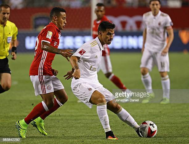 Fernandez Jesus of AC Milan passes under pressure from Timothy Tillman of FC Bayern Munich during a friendly match in the International Champions Cup...