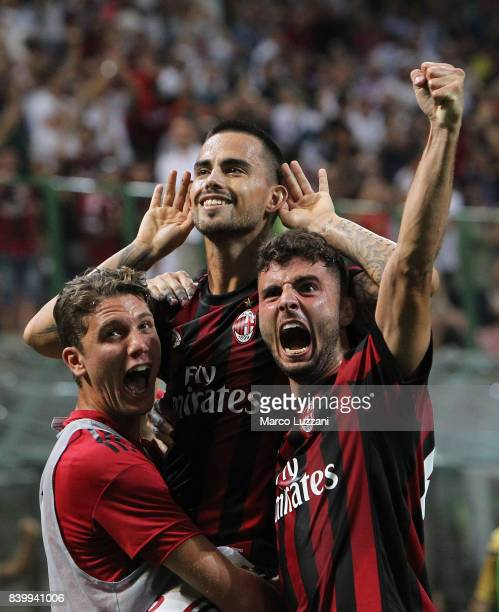 Fernandez Suso of AC Milan celebrates his goal with his teammates Patrick Cutrone and Manuel Locatelli during the Serie A match between AC Milan and...