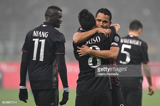 Fernandez Suso of AC Milan celebrates his second goal with team mate Carlos Bacca during the Serie A match between AC Milan and FC Internazionale at...