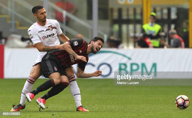 Fernandez Suso of AC Milan clashes with Giuseppe Pezzella of US Citta di Palermo during the Serie A match between AC Milan and US Citta di Palermo at...