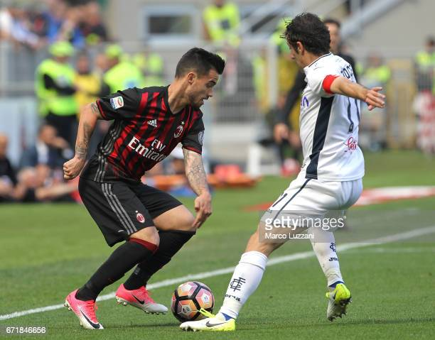 Fernandez Suso of AC Milan competes for the ball with Daniele Croce of Empoli FC during the Serie A match between AC Milan and Empoli FC at Stadio...