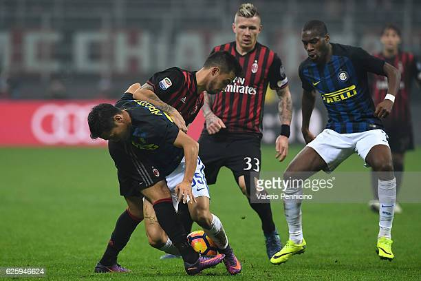 Fernandez Suso of AC Milan competes with Yuto Nagatomo of FC Internazionale during the Serie A match between AC Milan and FC Internazionale at Stadio...