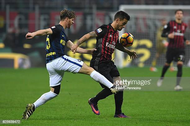 Fernandez Suso of AC Milan is challenged by Cristian Ansaldi of FC Internazionale during the Serie A match between AC Milan and FC Internazionale at...