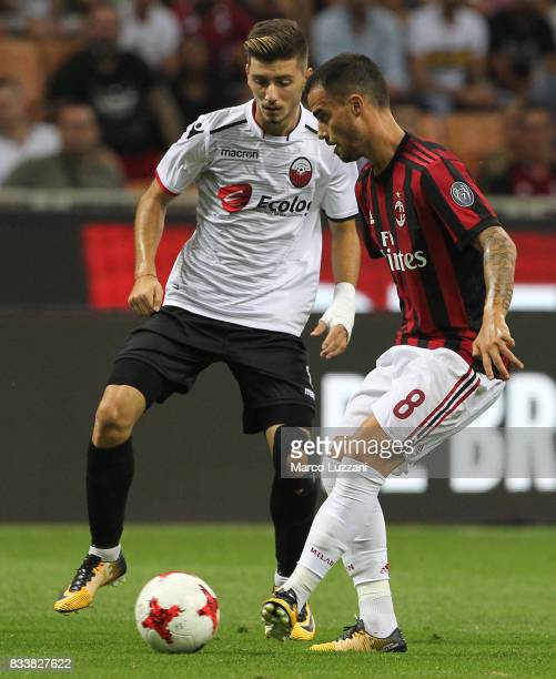 Fernandez Suso of AC Milan is challenged by Ennur Totre of KF Shkendija 79 during the UEFA Europa League Qualifying PlayOffs round first leg match...