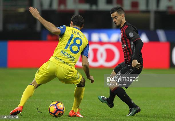 Fernandez Suso of AC Milan is challenged by Massimo Gobbi of AC ChievoVerona during the Serie A match between AC Milan and AC ChievoVerona at Stadio...