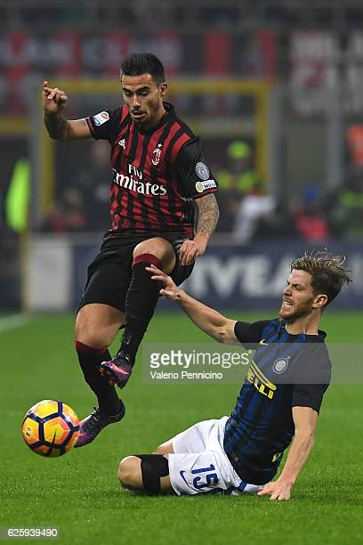 Fernandez Suso of AC Milan is tackled by Cristian Ansaldi of FC Internazionale during the Serie A match between AC Milan and FC Internazionale at...
