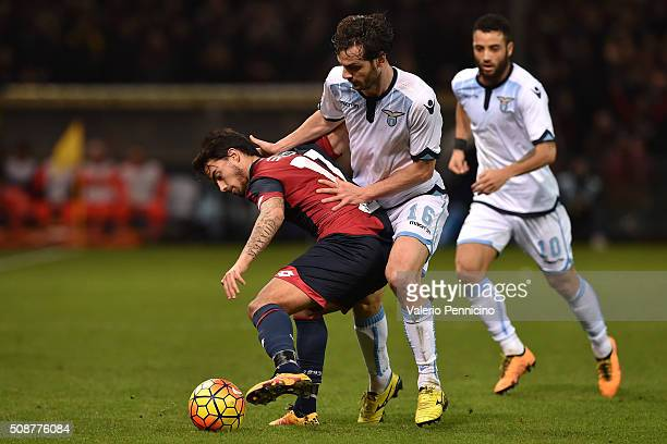 Fernandez Suso of Genoa CFC is challenged by Marco Parolo of SS Lazio during the Serie A match between Genoa CFC and SS Lazio at Stadio Luigi...