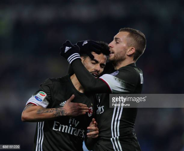 Fernandez Suso with his teammate Gerard Deulofeu of AC Milan celebrates after scoring the team's first goal during the Serie A match between SS Lazio...