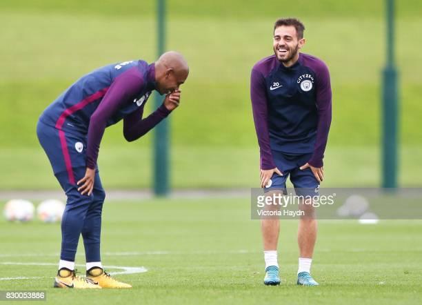 Fernandinho and Bernardo Silva during Manchester City training at Etihad Campus on August 11 2017 in Manchester England