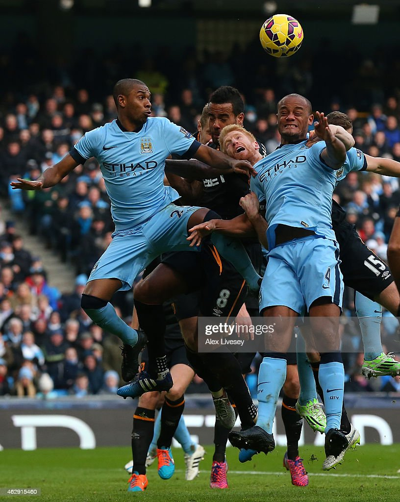 <a gi-track='captionPersonalityLinkClicked' href=/galleries/search?phrase=Fernandinho+-+Soccer+Player+-+Manchester+City&family=editorial&specificpeople=10093285 ng-click='$event.stopPropagation()'>Fernandinho</a> (L) and <a gi-track='captionPersonalityLinkClicked' href=/galleries/search?phrase=Vincent+Kompany&family=editorial&specificpeople=504694 ng-click='$event.stopPropagation()'>Vincent Kompany</a> of Manchester City defend against <a gi-track='captionPersonalityLinkClicked' href=/galleries/search?phrase=Paul+McShane&family=editorial&specificpeople=686252 ng-click='$event.stopPropagation()'>Paul McShane</a> and <a gi-track='captionPersonalityLinkClicked' href=/galleries/search?phrase=Tom+Huddlestone&family=editorial&specificpeople=735077 ng-click='$event.stopPropagation()'>Tom Huddlestone</a> of Hull City during the Barclays Premier League match between Manchester City and Hull City at the Etihad Stadium on February 7, 2015 in Manchester, England.