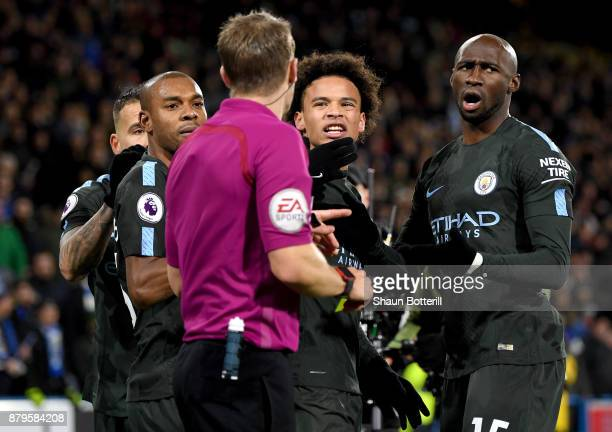 Fernandinho Leroy Sane and Eliaquim Mangala of Manchester City argue with the referee Craig Pawson after the Premier League match between...