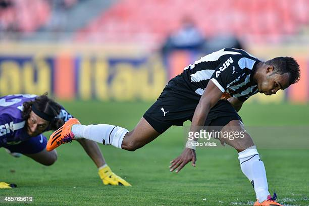 Fernandinho of Atletico MG and Cassio of Corinthians battle for the ball during a match between Atletico MG and Corinthians as part of Brasileirao...