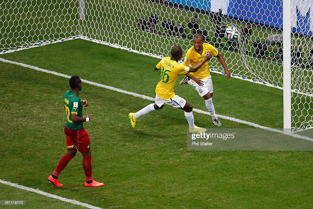 Fernandinho of Brazil (R) celebrates scoring his team's fourth goal with Ramires as <a gi-track='captionPersonalityLinkClicked' href=/galleries/search?phrase=Henri+Bedimo&family=editorial&specificpeople=2293105 ng-click='$event.stopPropagation()'>Henri Bedimo</a> of Cameroon looks on during the 2014 FIFA World Cup Brazil Group A match between Cameroon and Brazil at Estadio Nacional on June 23, 2014 in Brasilia, Brazil.