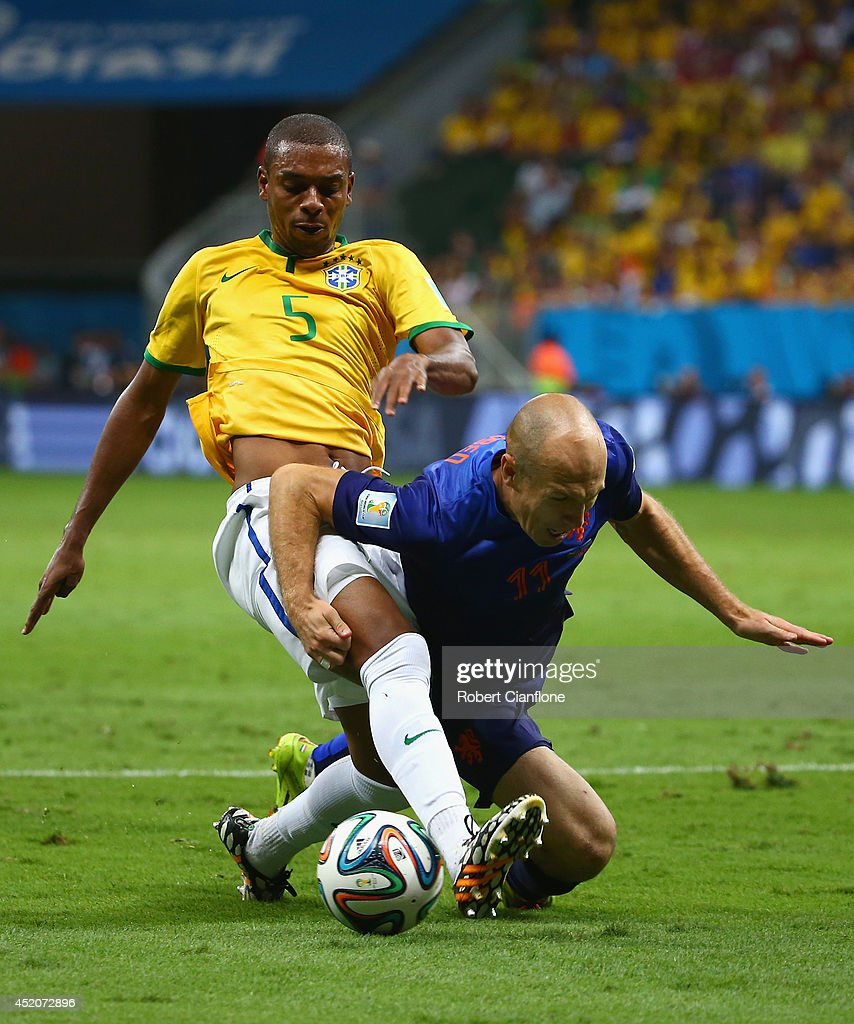 Fernandinho of Brazil challenges Arjen Robben of the Netherlands during the 2014 FIFA World Cup Brazil Third Place Playoff match between Brazil and the Netherlands at Estadio Nacional on July 12, 2014 in Brasilia, Brazil.