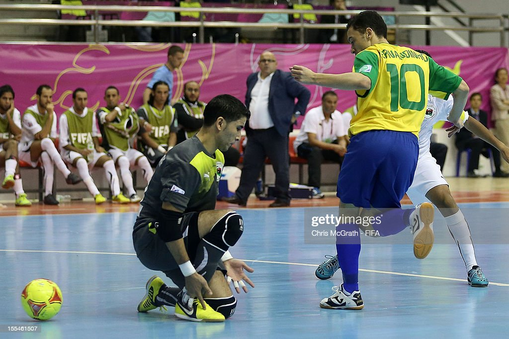Fernandinho #10 of Brazil kicks a goal against Libya during the FIFA Futsal World Cup, Group C match between Brazil and Libya at Korat Chatchai Hall on November 4, 2012 in Nakhon Ratchasima, Thailand.