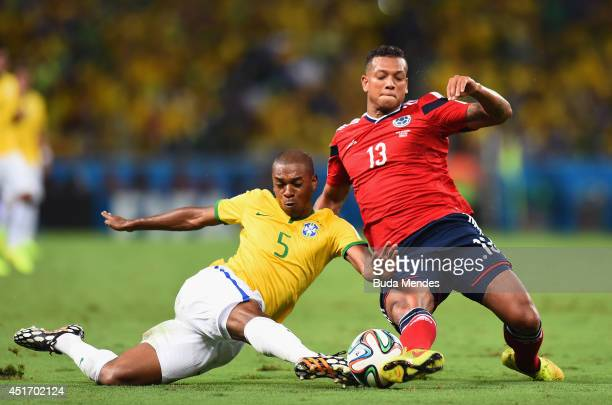 Fernandinho of Brazil tackles Fredy Guarin of Colombia during the 2014 FIFA World Cup Brazil Quarter Final match between Brazil and Colombia at...