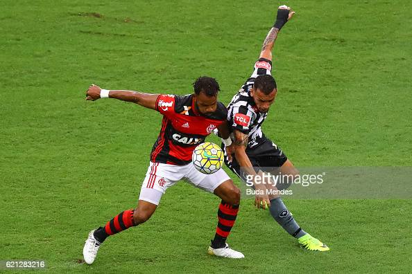 Fernandinho of Flamengo struggles for the ball Alemao with of Botafogo during a match between Flamengo and Botafogo as part of Brasileirao Series A...