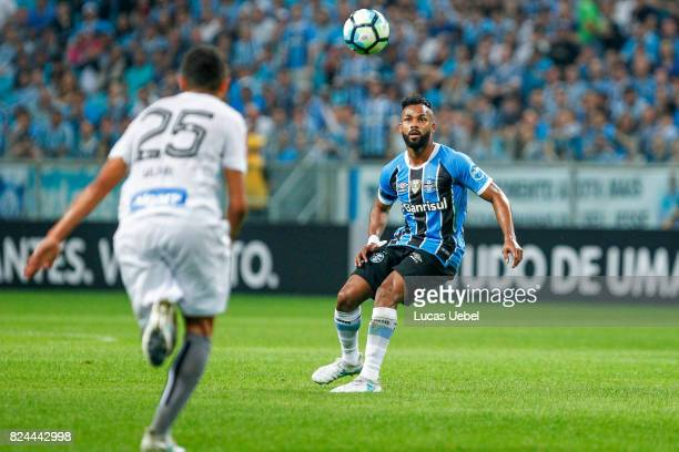 Fernandinho of Gremio battles for the ball against Alisson of Santos during the match Gremio v Santos as part of Brasileirao Series A 2017 at Arena...