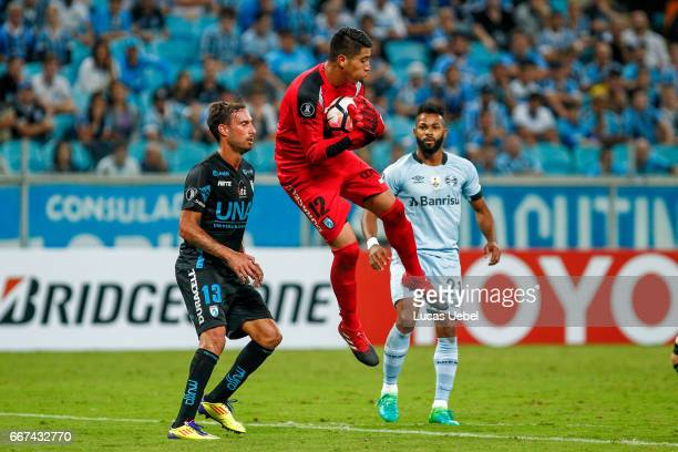 Fernandinho of Gremio battles for the ball against Bryan Cortes of Deportes Iquique during the match Gremio v Deportes Iquique as part of Copa...