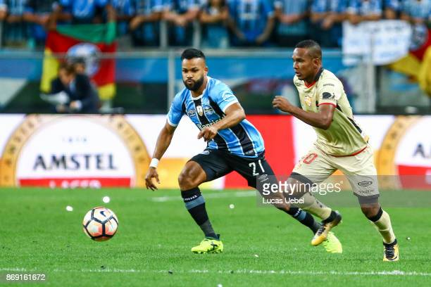 Fernandinho of Gremio battles for the ball against Eli Esterilla of Barcelona de Guayaquil during Gremio v Barcelona de Guayaquil match part of Copa...