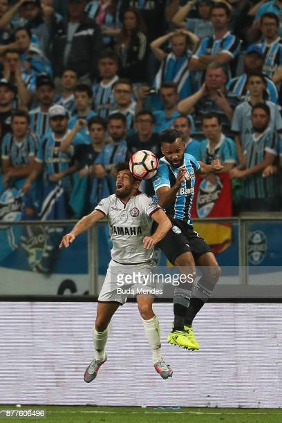 Fernandinho of Gremio struggles for the ball with Lautaro Costa of Lanus during a first leg match between Gremio and Lanus as part of Copa...