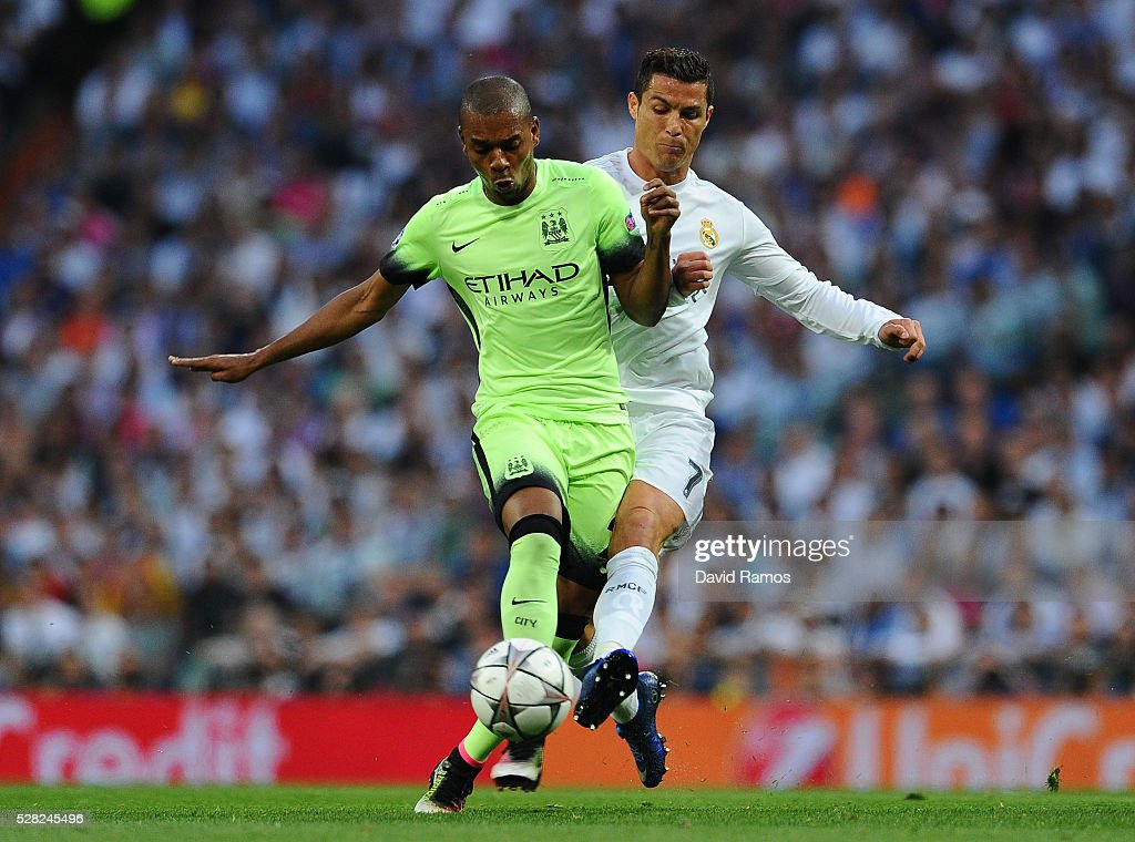 <a gi-track='captionPersonalityLinkClicked' href=/galleries/search?phrase=Fernandinho+-+Soccer+Player+-+Manchester+City&family=editorial&specificpeople=10093285 ng-click='$event.stopPropagation()'>Fernandinho</a> of Manchester City and <a gi-track='captionPersonalityLinkClicked' href=/galleries/search?phrase=Cristiano+Ronaldo+-+Soccer+Player&family=editorial&specificpeople=162689 ng-click='$event.stopPropagation()'>Cristiano Ronaldo</a> of Real Madrid battle for the ball during the UEFA Champions League semi final, second leg match between Real Madrid and Manchester City FC at Estadio Santiago Bernabeu on May 4, 2016 in Madrid, Spain.