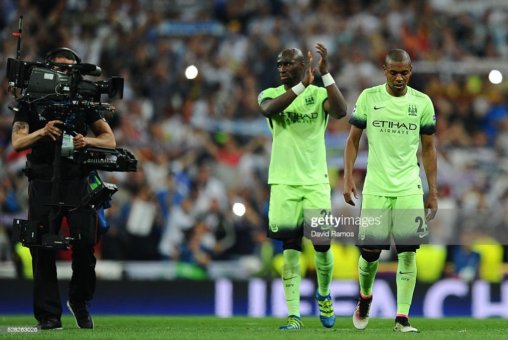 Fernandinho of Manchester City and Eliaquim Mangala of Manchester City look dejected during the UEFA Champions League semi final, second leg match between Real Madrid and Manchester City FC at Estadio Santiago Bernabeu on May 4, 2016 in Madrid, Spain.